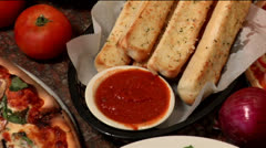 Pizza dinner, salad & breadsticks, zoom out - stock footage