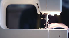 Sewing machine -  seamstress - sew a dress in a textile factory Stock Footage
