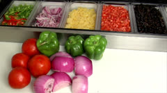 Vegetables at prep station 01 - stock footage