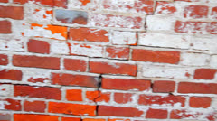 Red brick wall, and old white bricks and cement Stock Footage