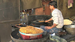 India Rajasthan Amber kitchen cooking strands of noodles 1 Stock Footage