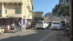 India Rajasthan Amber traffic past sandstone building Stock Footage