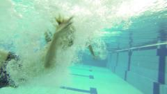 Child jumping in a pool Stock Footage