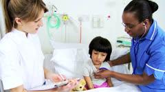 Pediatric Nursing Staff Recording Child Patient Care Stock Footage