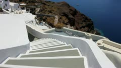 Woman on white stucco steps - stock footage