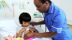 Specialist Nursing Staff Treating Child Patient - stock footage