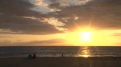 People Watch Sunset Over Ocean - stock footage