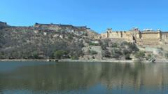 India Rajasthan Amber Palace between sky and lake  Stock Footage