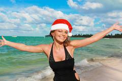 Stock Photo of happy woman in santa hat