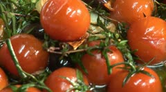 Frying tomatoes, olives and herbs Stock Footage