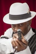 African American in retro mobster suit with handgun Stock Photos