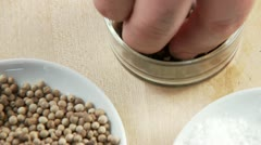Dishes of white peppercorns and juniper berries Stock Footage