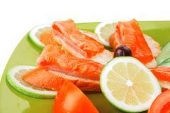 Fresh salmon sandwiches and vegetables Stock Photos