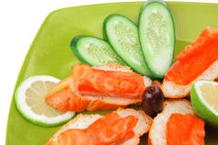 Fresh salmon sandwiches and vegetables Stock Photos