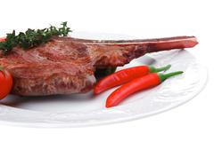 savory : grilled spare rib on white dish with pepper and tomato - stock photo