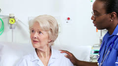 Multi Ethnic Hospital Staff Discussing Patient Treatment Stock Footage