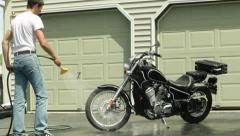 Man washing and rinsing off motorcycle ws timelapse Stock Footage