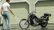 Stock Video Footage of man washing and rinsing off motorcycle ws timelapse