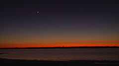 Dusk on the waterway, cresent moon and stars, 12fps Stock Footage