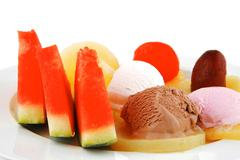 plate of fruits and icecream - stock photo