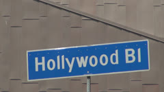 Hollywood Boulevard sign with modern building by day, Los Angeles, LA, USA Stock Footage