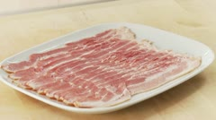 Rashers of bacon on a plate Stock Footage
