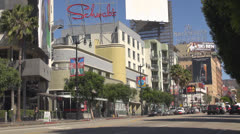 Traffic street in Hollywood downtown, Highland Boulevard, Blvd, LA, Los Angeles - stock footage