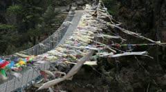 Buddhist prayer flags and Himalayas Stock Footage