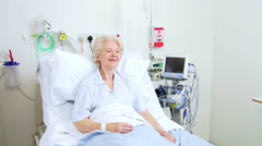Nurses Checking Progress Elderly Patient Hospital Bed Stock Footage
