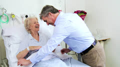 Older Patient Enjoying Hospital Visit Male Relative - stock footage