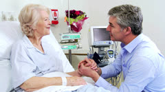 Female Patient Hospital Bed Reassured Caring Relative - stock footage