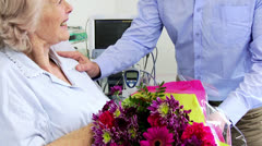 Son Visiting Elderly Mom Hospital Bringing Flowers Stock Footage