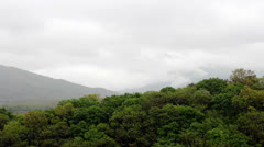 Clouds passing over mountain - stock footage