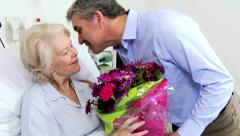 Senior Female Patient Bouquet Flowers Visiting Son Stock Footage