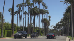 Traffic street in Beverly Hills by day, Hollywood Boulevard, Blvd, Los Angeles, Stock Footage