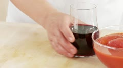 A hand taking a glass of red wine Stock Footage