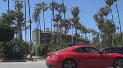 Traffic street in Beverly Hills by day, Hollywood Boulevard, Blvd, Los Angeles, - stock footage