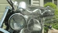 Stock Video Footage of man washing motorcycle cu of headlight rinsing off