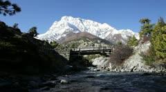 Small foot-bridge on Himalayas mountains Stock Footage