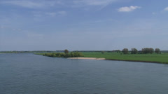 River Rhine at Emmerich, Germany + pan ship tanker sails downstream Stock Footage
