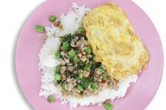 Basil fried pork with omelet & rice Stock Photos