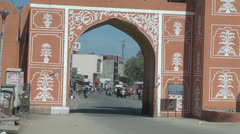 India Rajasthan Jaipur pink gate arch and bike traffic 4 Stock Footage