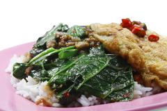 Chinese broccoli with minced pork & omelet on rice Stock Photos