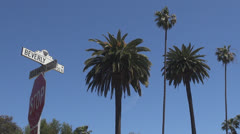 Beverly Hills sign with palm tree by day, Hollywood, Los Angeles, LA, California Stock Footage