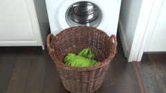 Clothes falling in laundry basket Stock Footage