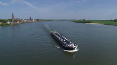 Tanker sails downstream River Rhine at Emmerich, Germany Stock Footage