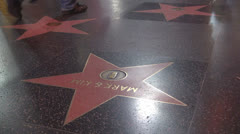 Tourists passing on Walk of fame by night, Hollywood Boulevard, Los Angeles, USA Stock Footage