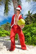 santa under tropical palm - stock photo