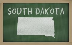 outline map of south dakota on blackboard - stock illustration
