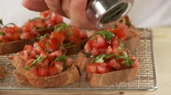 Bruschetta being sprinkled with pepper Stock Footage